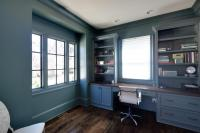 A view of the main floor study with custom painted built in desk and shelving.