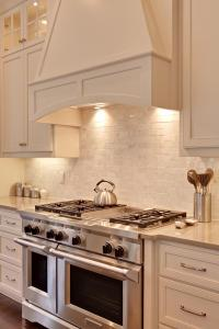 Close up of the Viking range and Carrera marble backsplash.