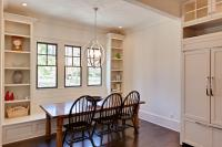 Breakfast area with built in bench seating and bookshelves.