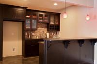Close up of the terrace level bar with slate backsplash and leathered granite counters.