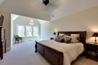The master bedroom and sitting area, both with vaulted ceilings.
