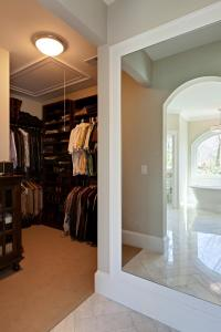 """His"" side of the master closet with custom built in mirror."