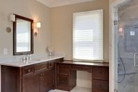 "Master bath ""hers"" vanity with built in makeup desk and stained wood top."
