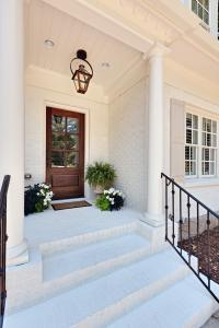 Another view of the finished front porch with painted brick stoop and steps.