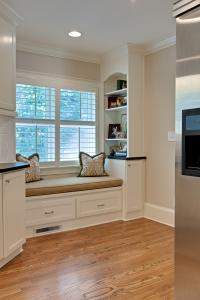 Built in seating and shelving between the kitchen and newly created rear entry.